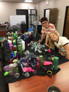 Sustainability Office staff and volunteers drying the next batch of water bottles.