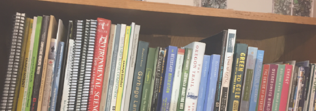 A bookshelf loaded up with leather-bound sustainability knowledge.